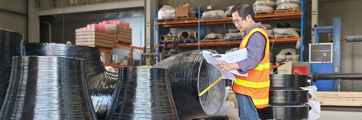 Engineer measuring pipe fitting