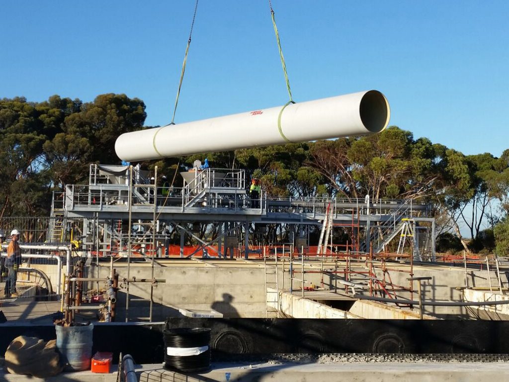 Novaflo 500 series GRP piping lifted into place on construction site