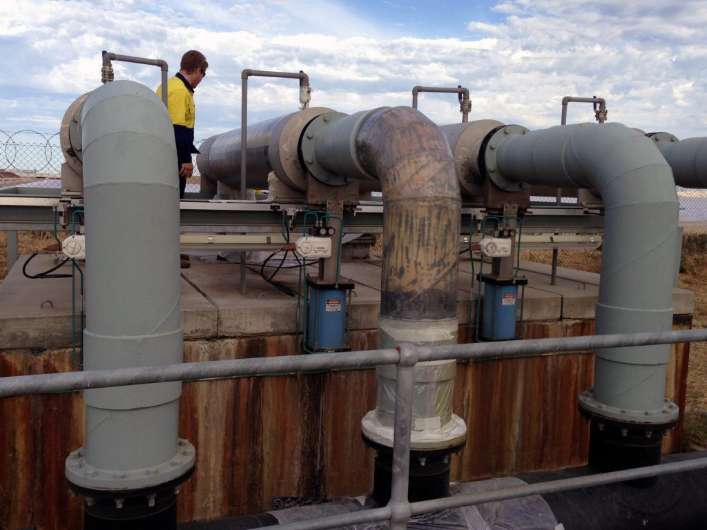 Novawrap being applied during repair to composite pipe